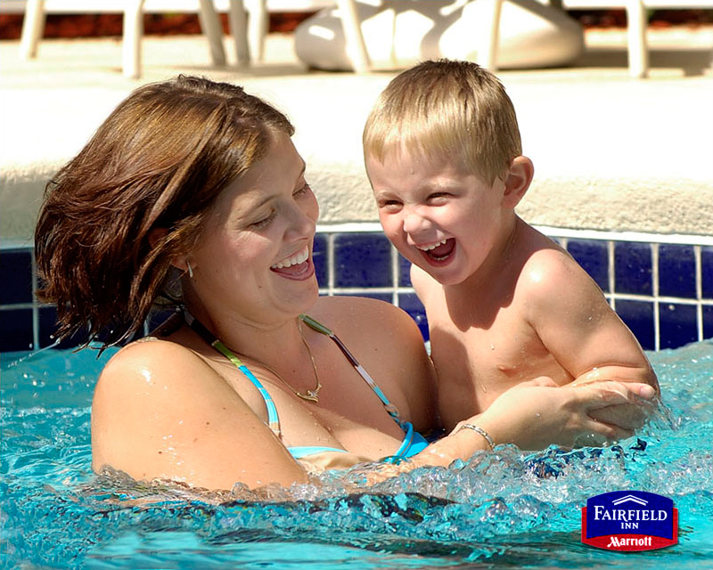 mother and son in pool model photography in austin by doug heslep photography
